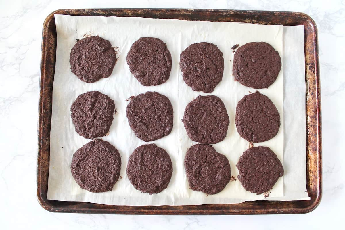 Finished chocolate cookies on a baking sheet lined with parchment paper