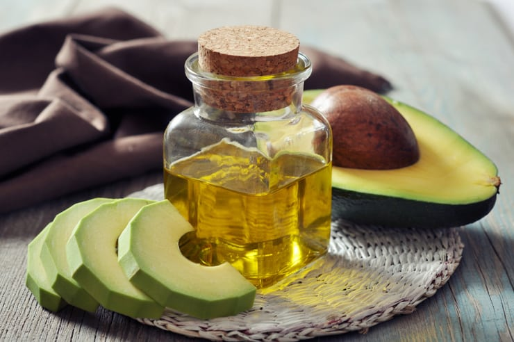 bottle of avocado oil and avocados
