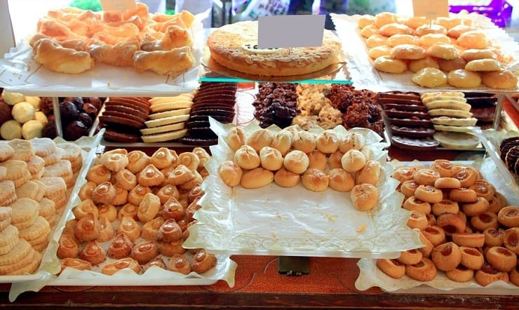 A photo of cakes in a window of a bakery