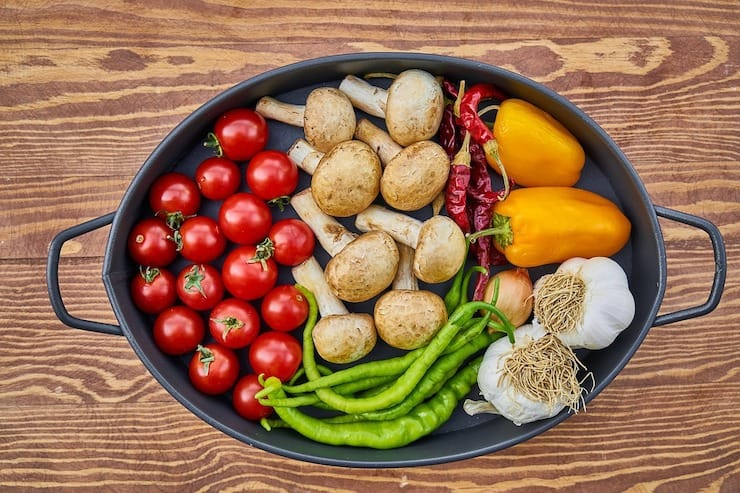 Tray of various vegetables on a wooden table