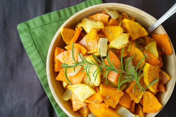 An overhead shot of roasted squash in a bowl