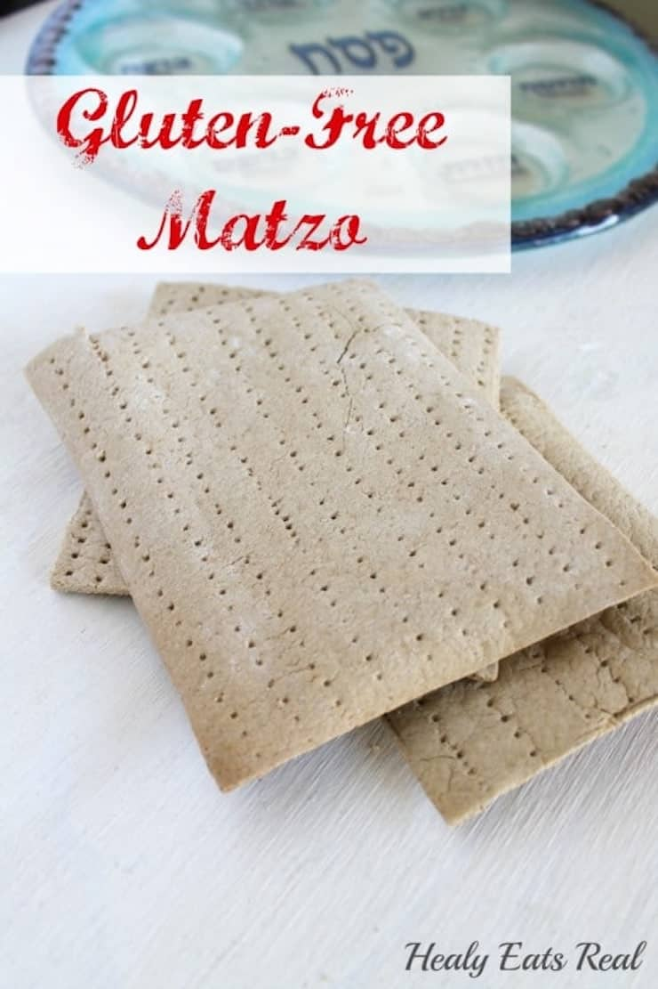 3 sheets of gluten free matzo on a white wooden table next to a clear and blue seder plate