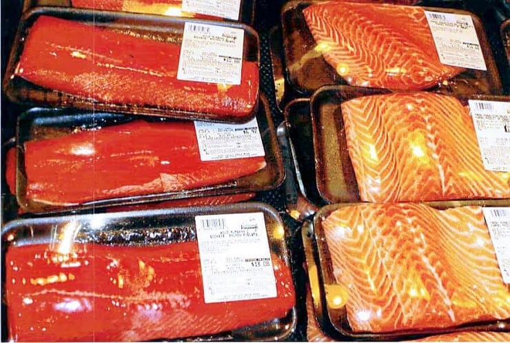 A photo of packaged wild salmon and farmed salmon in a supermarket