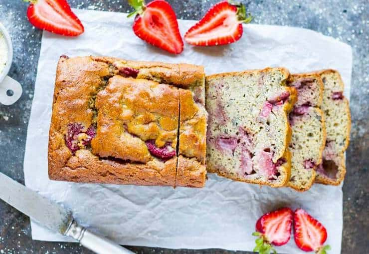 overhead view of whole loaf of strawberry bread with four slices out of it