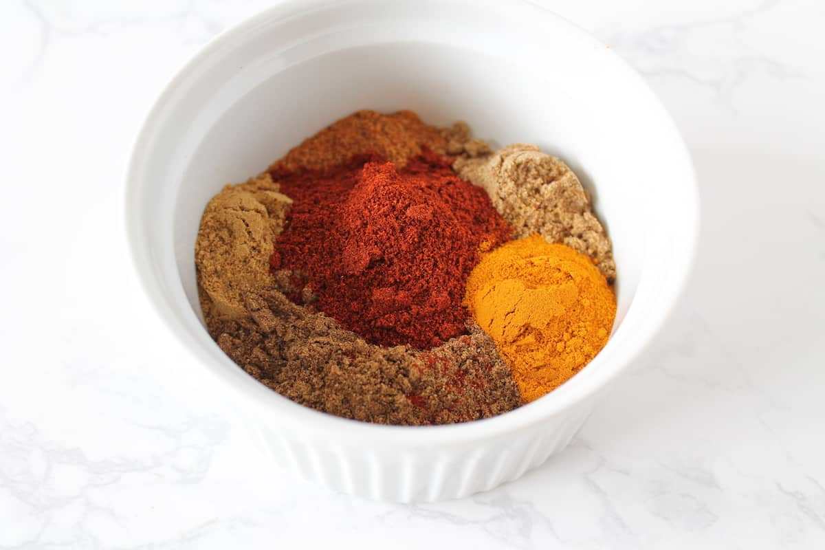 White bowl filled with colorful spices