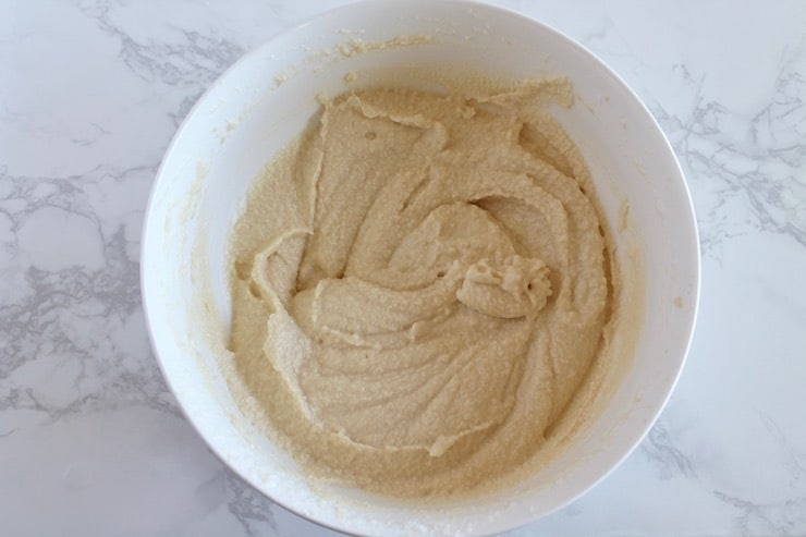 Paleo biscuit batter in white bowl on marble counter