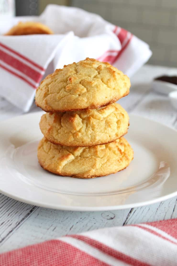 Close up of a stack of three yellow paleo biscuits