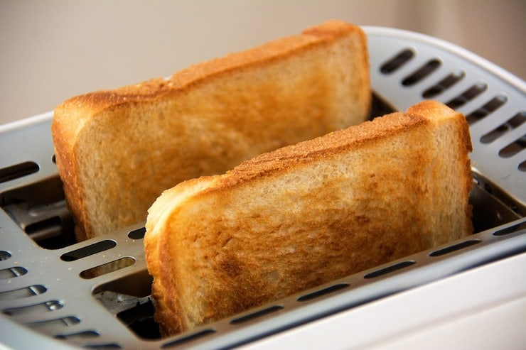 2 slices of toast in a toaster