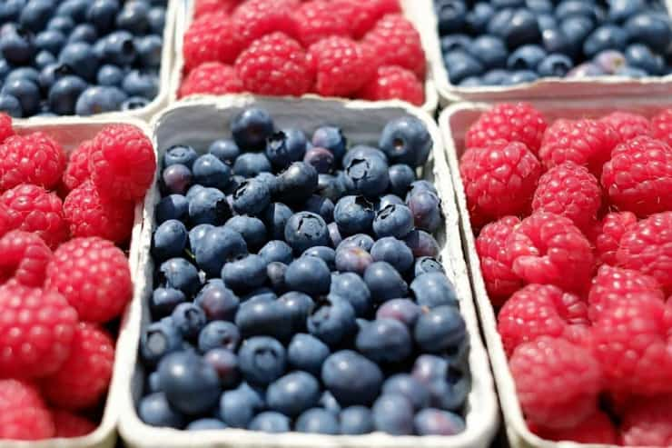 A close up of punnets of berries