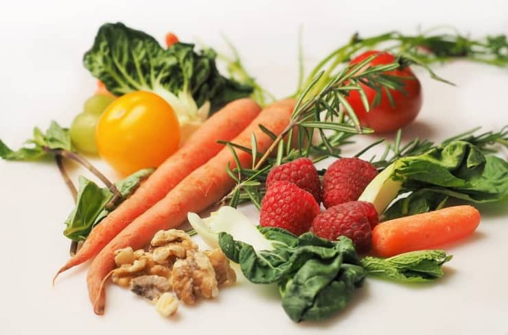 Ingredients on a white surface for making recipes on an Adrenal fatigue diet