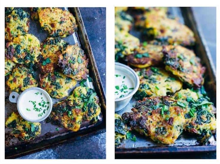 Bacon and kale fritters on metal baking sheet with small cup of sauce