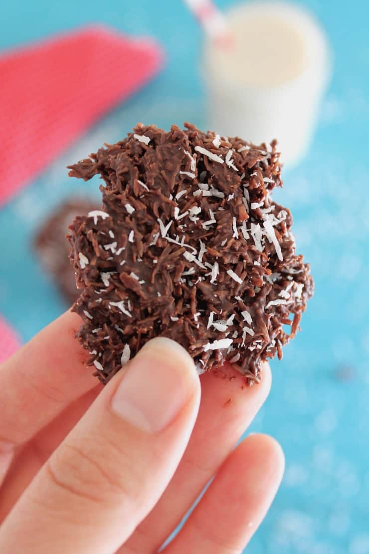 Hand holding a chocolate coconut haystack cookie