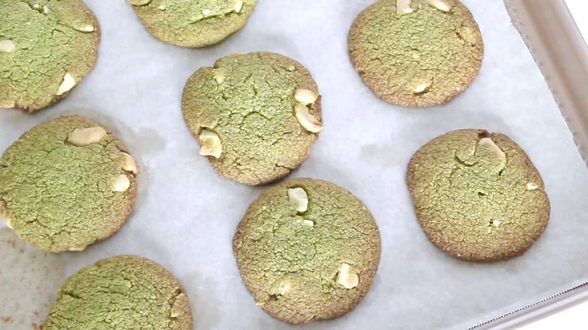 Baked matcha green tea cookies on a baking sheet lined with parchment paper