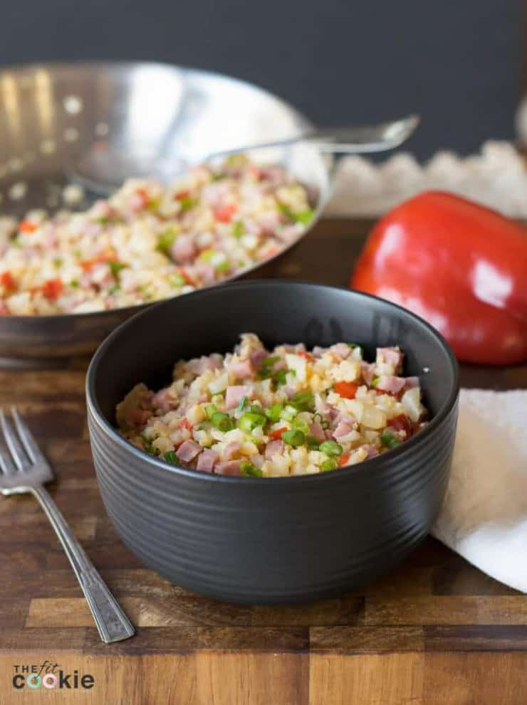 Pork fried rice in a small black bowl