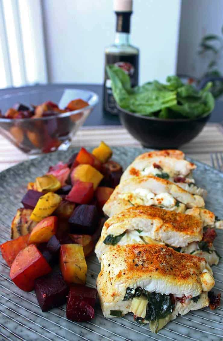 Stiffed chicken breast cut into slices on a plate with vegetables