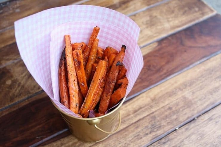A stack of carrot fries in a tub