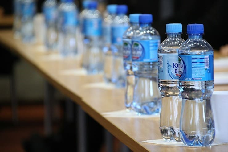 Plastic Water bottles on a table in a row