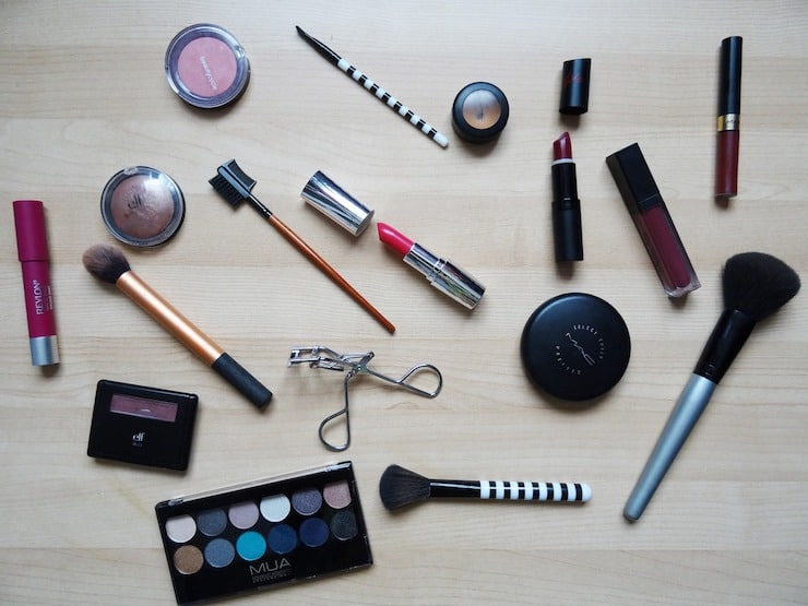 Various array of makeup products laid out on a table