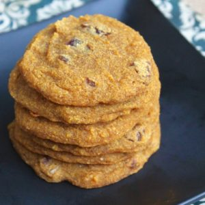 A close up of pumpkin cookies stacked on top of each other