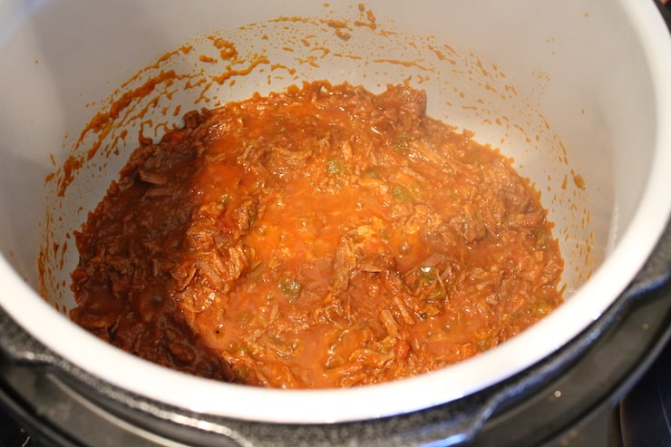 Instant pot filled with shredded beef for tacos